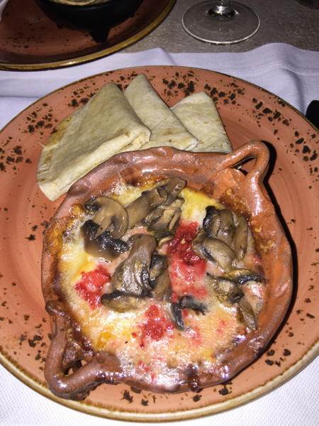 Lizo - appetizer of melted cheese with mushrooms by...