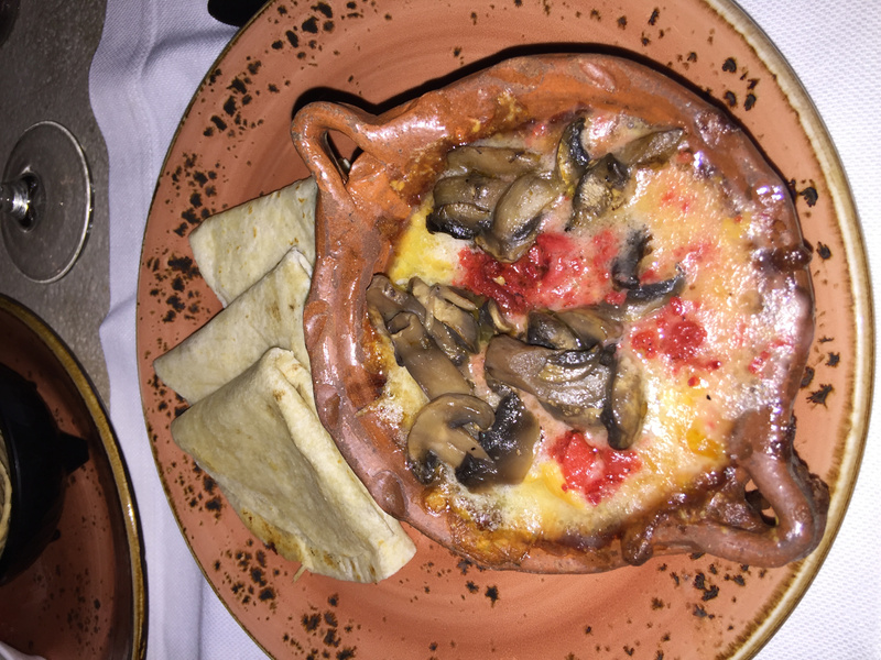 Lizo - appetizer of melted cheese with mushrooms