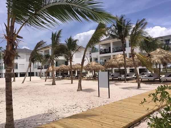 EC beach area between beach houses and ocean by...