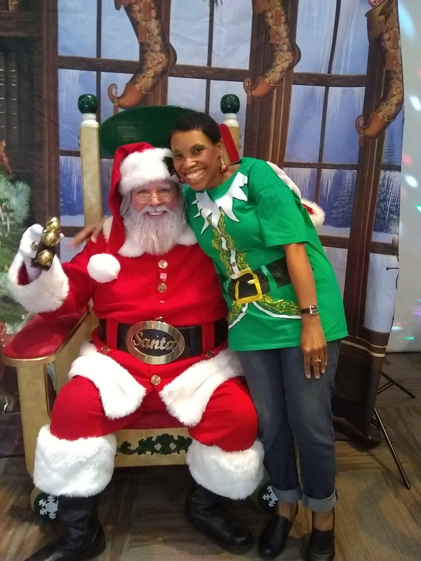 Joshland Shervette and Santa Claus at The JS Jewelry and CD Collection on November 12, 2017.