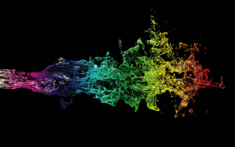 rainbow_colored_fluid_shaped_object_with_a_black_background