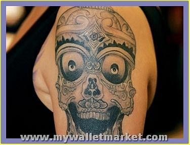 alien-skull-tattoo-on-left-shoulder by catherinebrightman