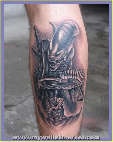 best-grey-ink-alien-tattoo-on-back-leg