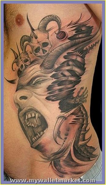 crawling-alien-tattoo-on-rib-side by catherinebrightman