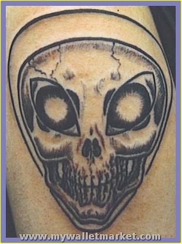 grey-ink-alien-skull-tattoo by catherinebrightman