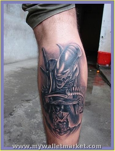 grey-ink-alien-tattoo-on-back-leg by catherinebrightman