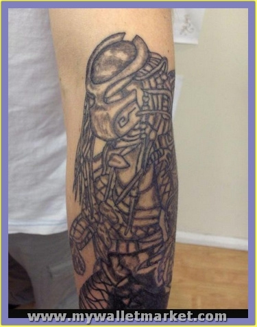grey-ink-alien-tattoo-on-left-arm by catherinebrightman