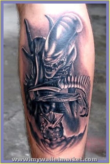 classic-grey-ink-alien-tattoo-on-back-leg by...