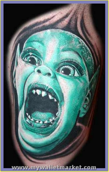 crawling-alien-kid-face-tattoo by catherinebrightman