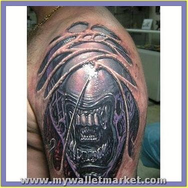 monster-alien-head-tattoo-on-left-shoulder