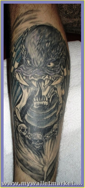 scary-alien-tattoo-design-on-arm