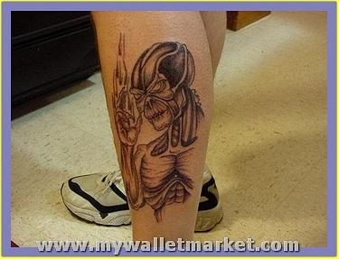 stylish-alien-tattoo-on-leg by catherinebrightman