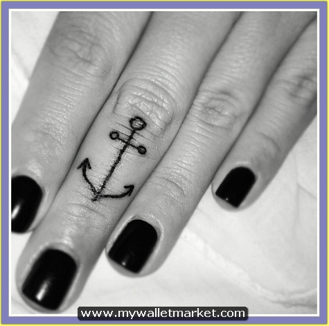 black-anchor-tattoo-on-middle-finger by...