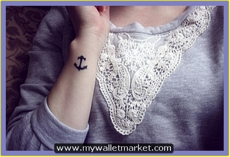 tiny-anchor-symbol-tattoo-design by catherinebrightman
