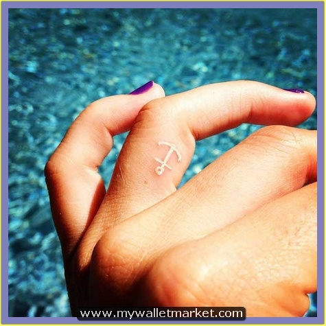 white-ink-small-anchor-tattoo-on-finger by catherinebrightman